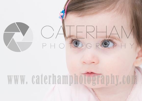 Surrey portrait photographer- in studio- baby model looking away