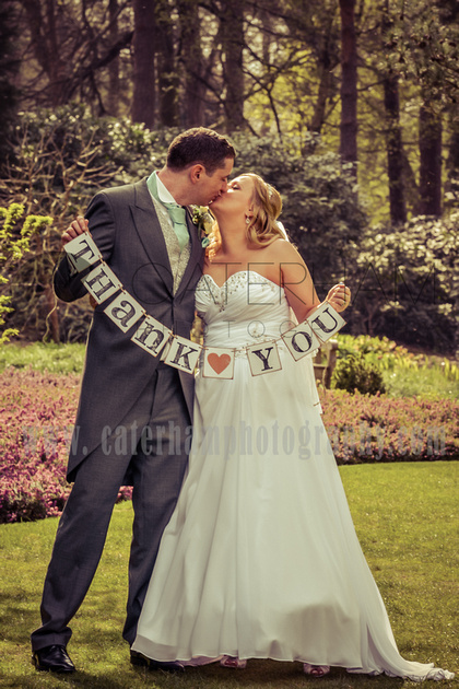 "Surrey wedding photographer- girlvintage wedding / The bride and groom kiss ""thank you"""