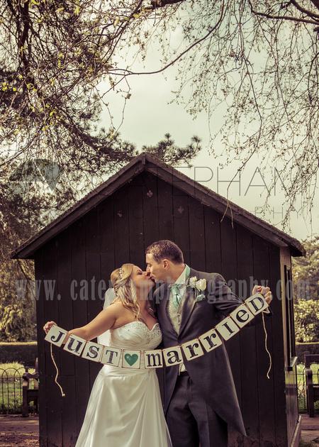 "Surrey wedding photographer- wedding / Bride and groom kiss ""Just Married"""