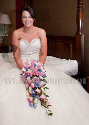Surrey wedding photographer /Legacy Thatchers Hotel Wedding sitting on the bed waiting (5)