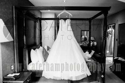 Surrey wedding photographer /Legacy Thatchers Hotel Wedding the hanging dress 21