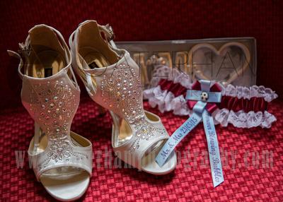 Surrey wedding photographer /Legacy Thatchers Hotel Weddings the shoes and garter 22