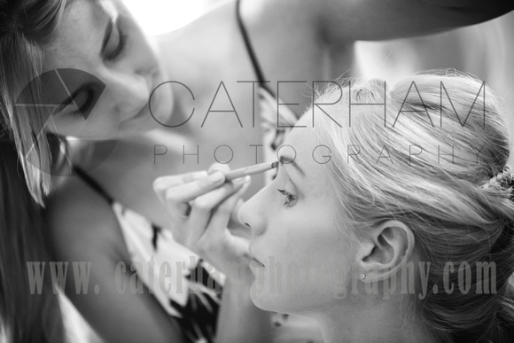 Surrey wedding photographer- Bridal Preparation- bridesmaids having makeup done