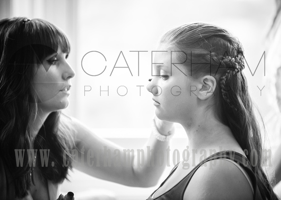 Surrey wedding photographer- Bridal Preparation - young bridesmaid getting hair and makeuo
