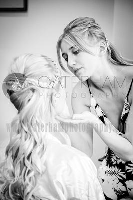surrey wedding photographer- finishing the brides makeup- Bridal Preparation