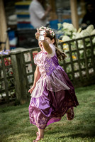 Surrey party photographer- themed party- young girl running