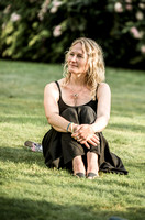 surrey party photographer- woman sat on grass- themed party