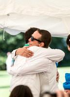 Surrey wedding photographer / marquee wedding (6) The grooms and best-man hug