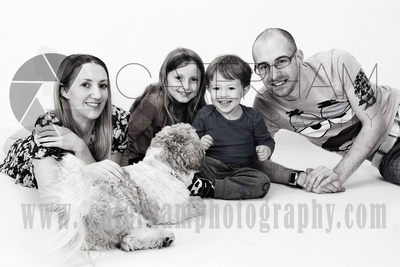 Surrey Portrait Photographer-  Surrey photographer - Great family portrait and happy family and the cute dog