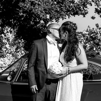 surrey wedding photographer- leatherhead registry office- bride and groom by car