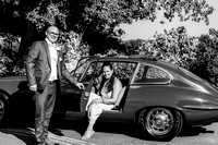 surrey wedding photographer- leatherhead registry office- groom helping bride out of car
