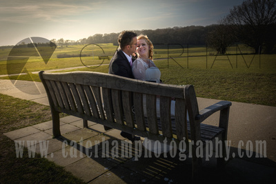 Surrey Wedding Photographer- Warlingham Farleigh Golf Club- bride and groom sat in Wedding venue grounds