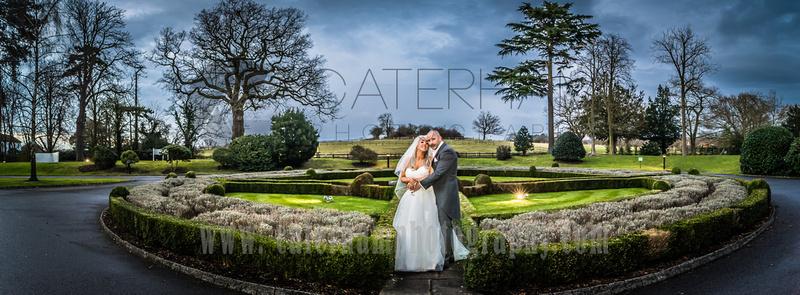 Surrey wedding photographers- Woodland Park Hotel surrey- married couple stood outside wedding venue