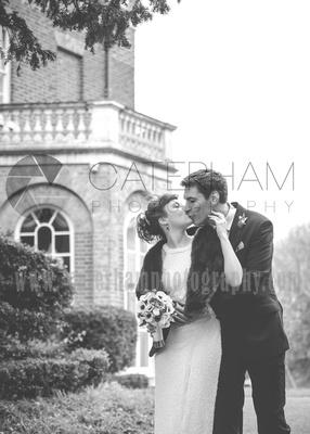 surrey wedding photographer- merton register office morden park house-  bride and groom kissing