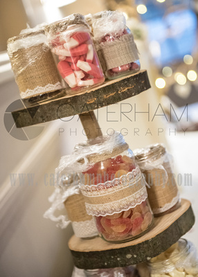 Surrey Wedding Photographer-  Reigate manor hotel- sweet jars on wedding table