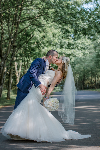 Surrey Wedding Photographer- Nutfield Priory- the bride and groom kissing 26