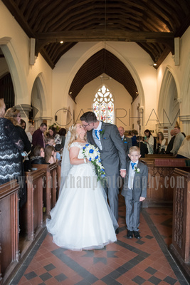 Surrey Wedding Photographer- St Nicholas Church Godstone- Bride and Groom having a Traditional Church wedding