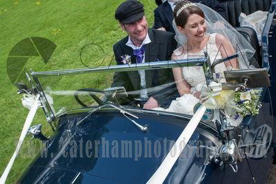 Surrey wedding photographer - Hartsfield Manor- Wedding car with Bride and Groom in