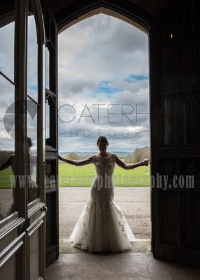 Surrey Wedding Photographer- Chiddingstone Castle- Bride in archway