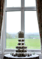 Surrey Wedding Photographer- Chiddingstone Castle Weddings- Cakes in the window