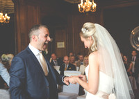 Surrey Wedding Photographer- Nutfield Priory- Giving of the rings 15