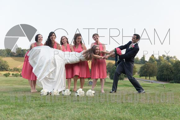 Surrey wedding photographer- Woldingham Golf Club- tug of war with bride groom and bridesmaid