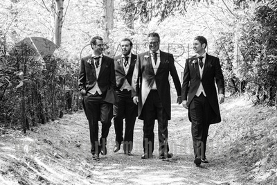 Surrey wedding photographer- Photographed Wedding at St Mary's Church in Dorking- Groom and Best men walking in the dorking countryside