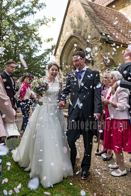 Surrey wedding photographer- Photographed Wedding at St Mary's Church in Dorking- Happily Married Bride and Groom leaving the church on their Wedding Day