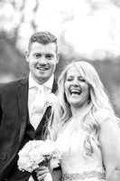 Surrey wedding photographers / Mulberry House Weddings/ The wedding couple laughing / Happy bride and groom
