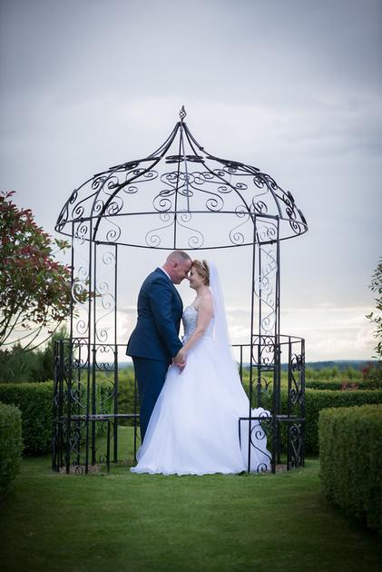 Surrey wedding photographer - wedding at Cain Manor - bride and groom portrait sunset