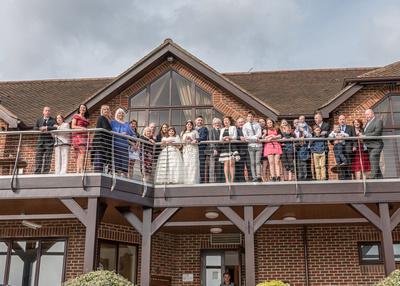 Surrey Wedding Photographer- Wedding ceremony at westerham golf club- Groom and best men stood outside wedding venue