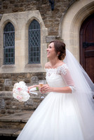Surrey Wedding Photographer- selsdon park hotel- bride with flowers outside church