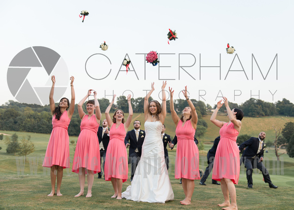 Surrey wedding photographer- Woldingham Golf Club- throwing flowers to each other