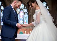 Surrey Wedding Photographer- selsdon park hotel- bride and groom rings