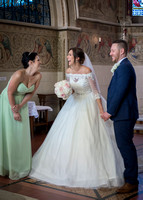 Surrey Wedding Photographer- selsdon park hotel- bride and groom at church lauging