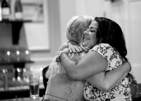 Surrey Wedding Photography - Woldingham Golf Club- guests hugging black and white