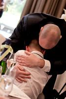 Surrey wedding photographer- selsdon park hotel- men hugging inside