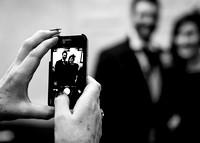surrey wedding photographer - wedding mercure box hill burford bridge- bride and groom picture on phone