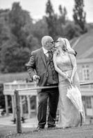 Surrey Wedding Photography - Woldingham Golf Club- bride and groom kissing on tennis court black and white