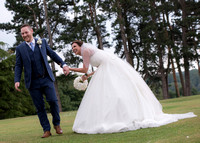 Surrey Wedding Photographer- selsdon part hotel- bride holding grooms hand whilst trying to pull hand cute