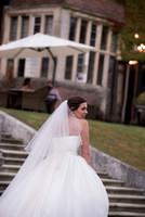 Surrey Wedding Photographer-  Selsdon Party Hotel- Bride Sat on steps outside venue