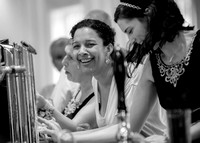 Surrey Wedding Photography - Woldingham Golf Club- wedding guests at bar black and white