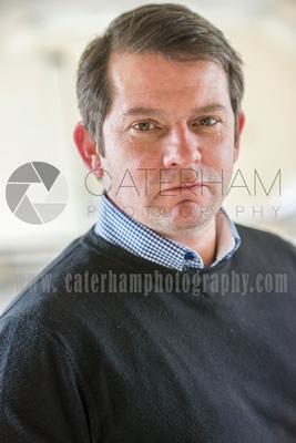 Surrey portrait photographer- man Office headshot checked shirt