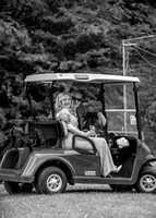 Surrey Wedding Photography - Woldingham Golf Club- bride and groom driving golf cart black and white
