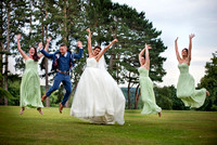 Surrey wedding photographer- selsdon park hotel- bride and groom and bridesmaids jumping in countryside