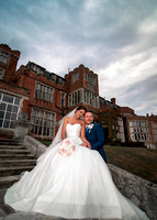 Surrey wedding photographer- selsdon park hotel- bride and groom on stairs