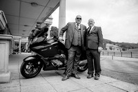 Surrey Wedding Photography - Woldingham Golf Club- men outside with bike black and white