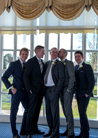 Surrey wedding photographer- leatherhead register office-groomand best men kissing