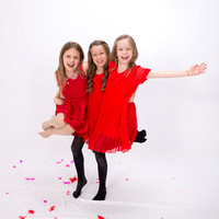 Kids photographer surrey / kids party photoshoot/ Little girls in red dresses / Fun photos