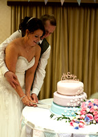 Surrey wedding photographer : Bride and groom cutting the wedding cake Legacy Thatchers Hotel Wedding